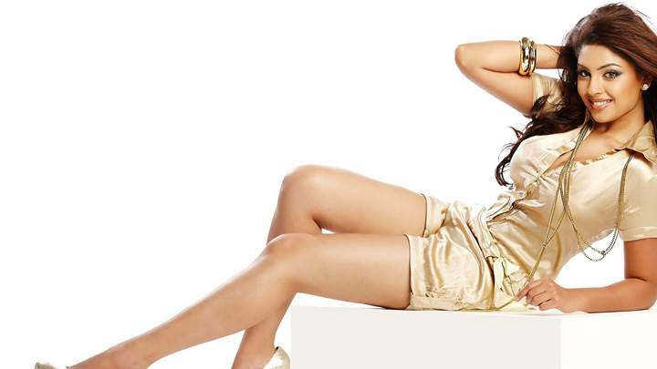 Richa Gangopadhyay Sitting on Stool In Golden Dress